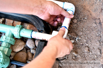 Glue PVC together to connect to the sprinkler system's valves