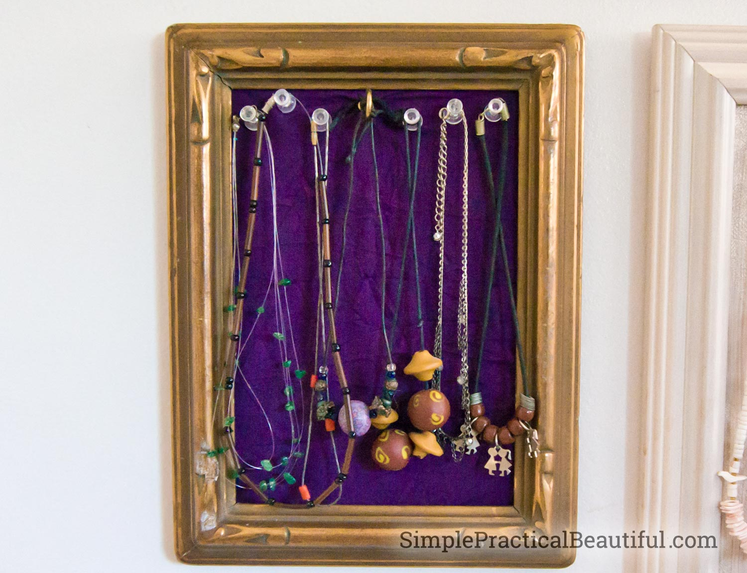 push-pins holding necklaces