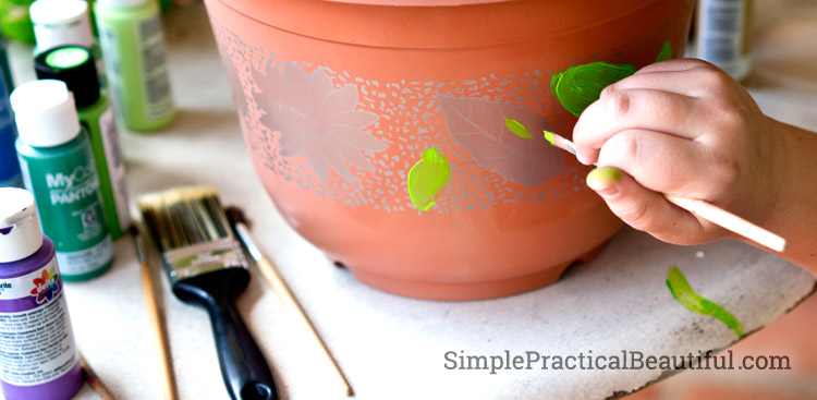 Painting a dollar store pot to make a fairy garden