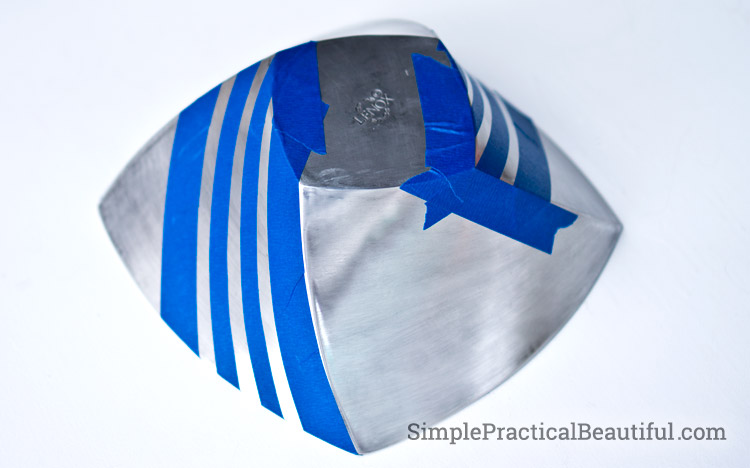 Taping off stripes on a brushed metal bowl
