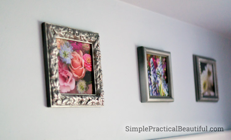 A collection of small frames are perfect above a closet