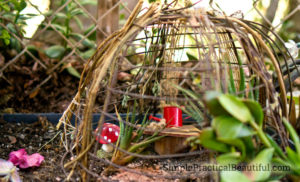 A fairy greenhouse upcycled from a wire baskets
