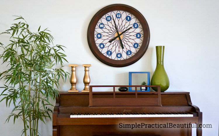 Tutorial on how to refinish a clock frame and add a new clock face in the style of your home.
