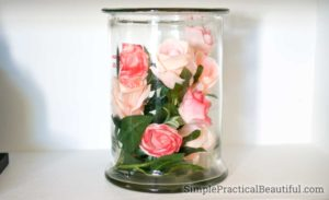Fill a glass vase with silk flowers for colorful decor