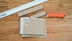 Create your own butterfly patch with drywall to repair a hole in the wall