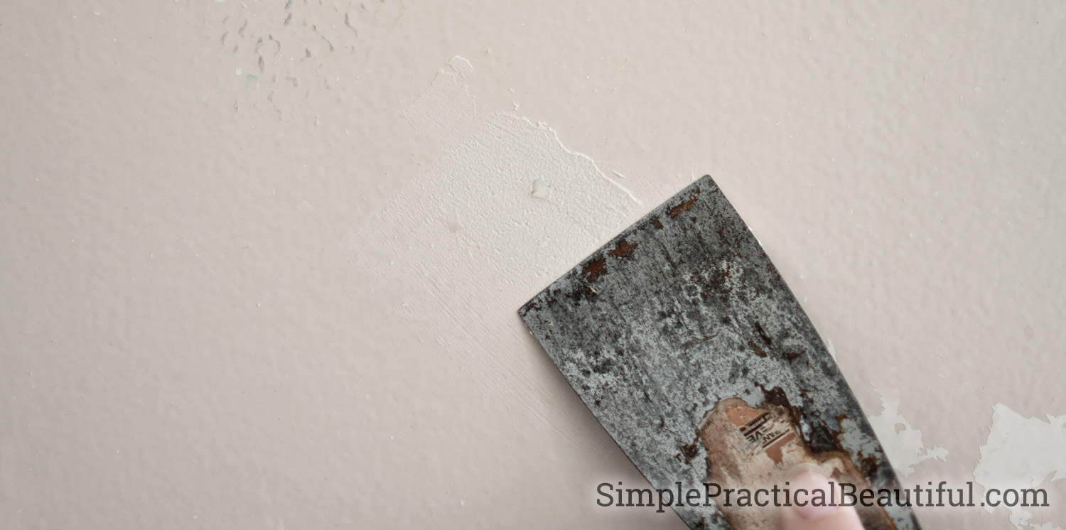 Use a putty knife and spackle to repair a hole in the wall from a picture frame