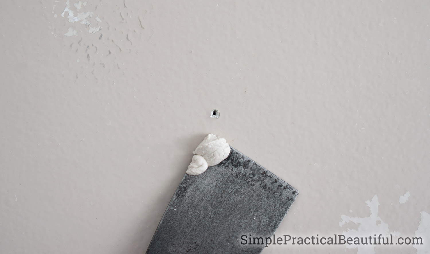 patch a small hole left by a picture from nail with spackle