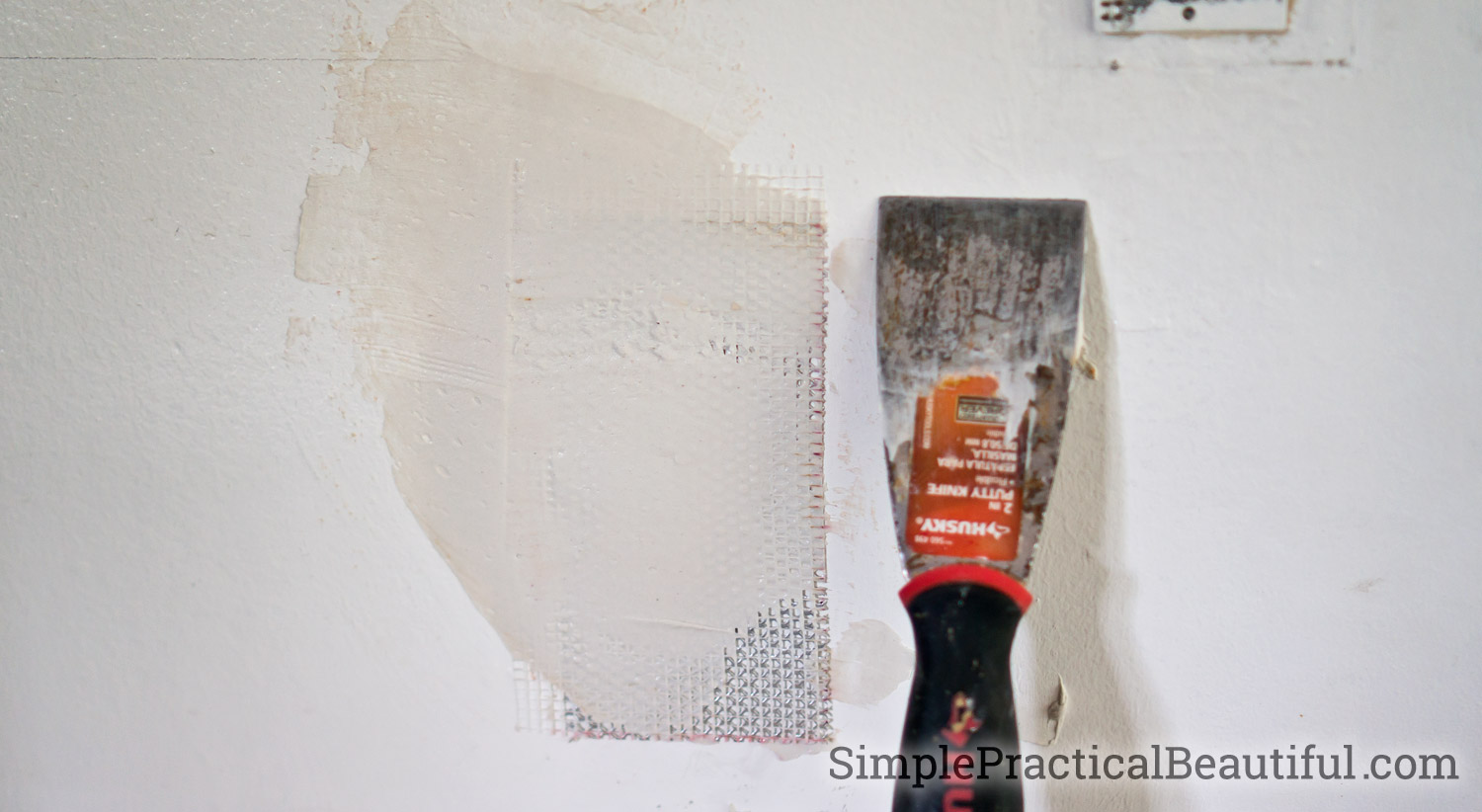 Use a patch kit to repair a hole in the wall