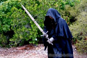A nazgul or ringwraith costume with a sword