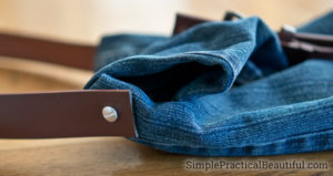 Attach the belt to the jean bag to use as a purse strap