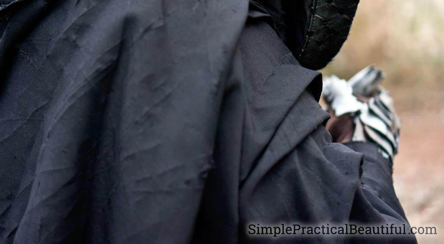 Make folds in the Nazgul cloak to create the flow of a Lord of the Rings Ringwraith costume