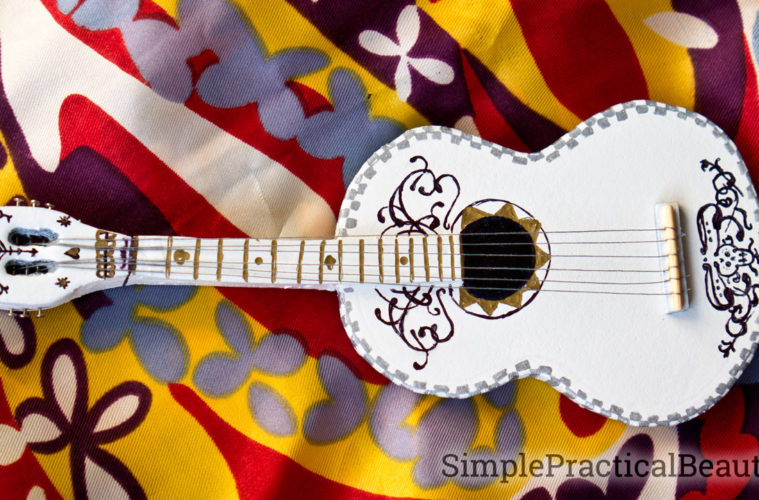 A miniature guitar made to look like the Coco guitar