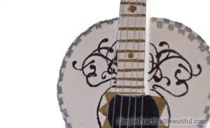 A miniature guitar made to look like the Coco guitar detail