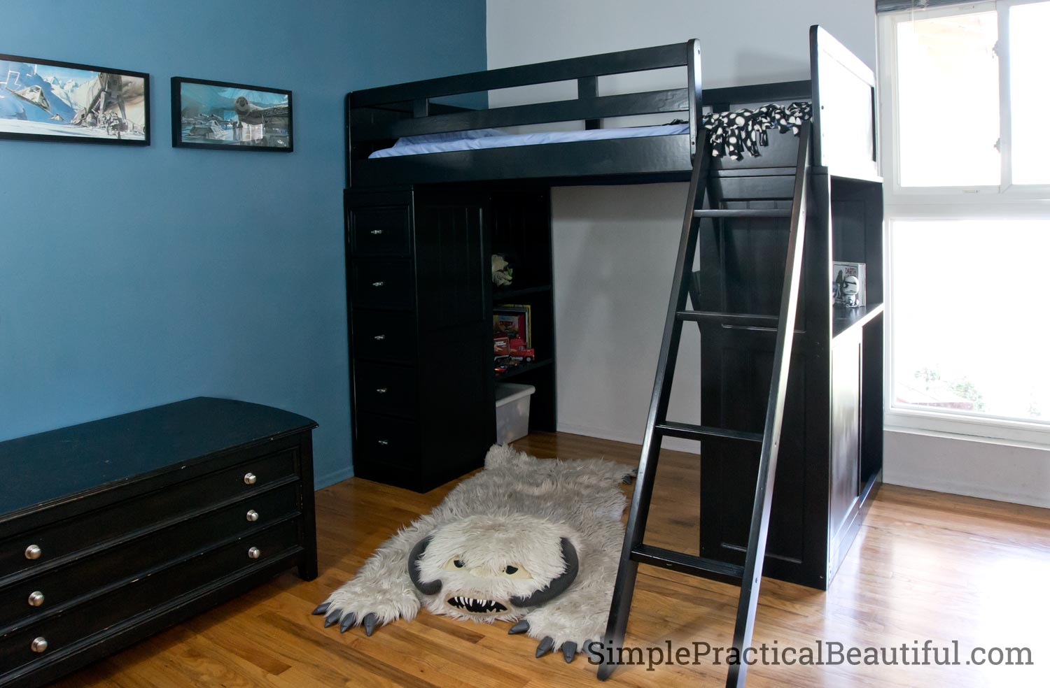 A loft bed refinished in black to work in a Star Wars bedroom as part of The Fab Furniture Flippin Contest
