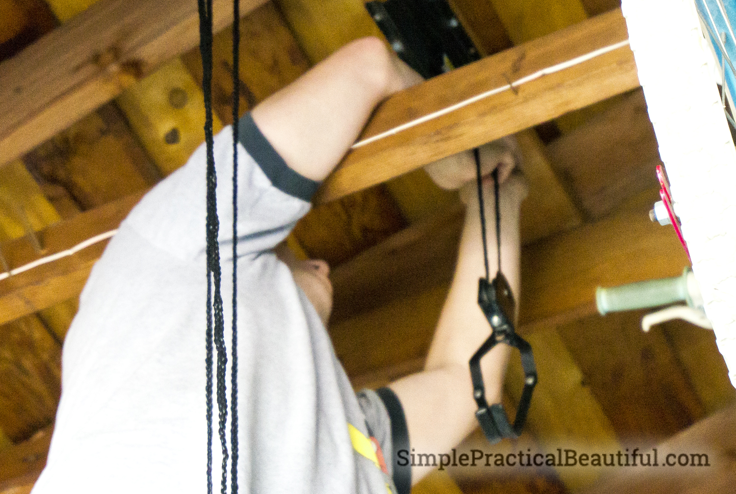 Thread the rope through the pulley and the hook