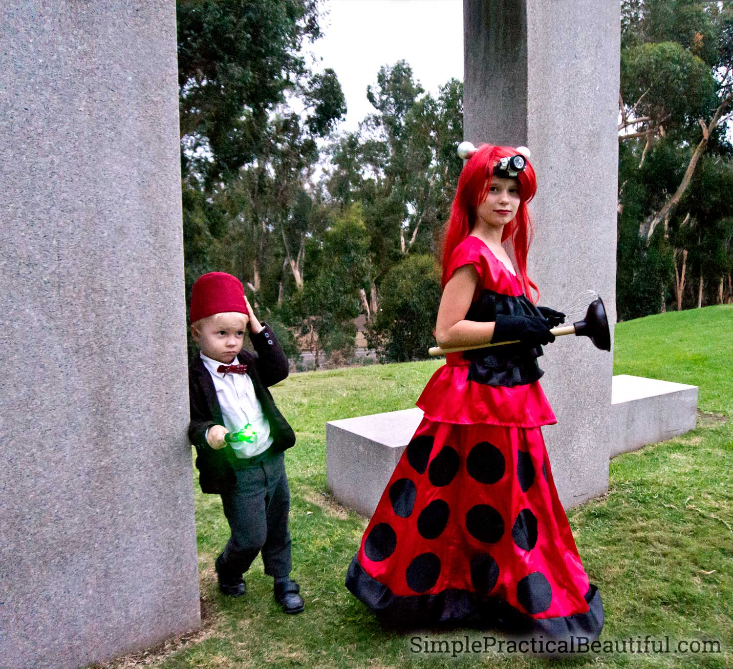 A Dalek costume dress and a mini 11th Doctor