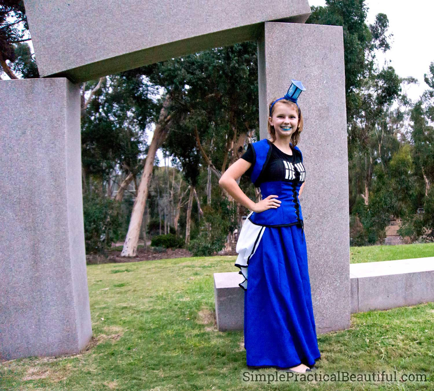 A steampunk Tardis Costume with a lighted headband