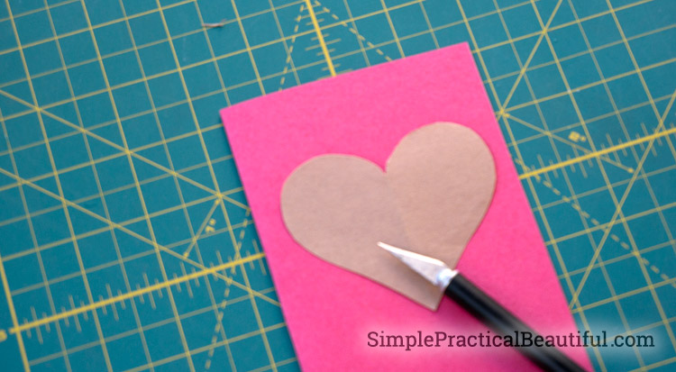 Cut half of the heart on the Valentine card
