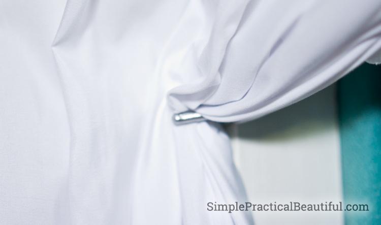 Use coat hooks as curtain tie backs