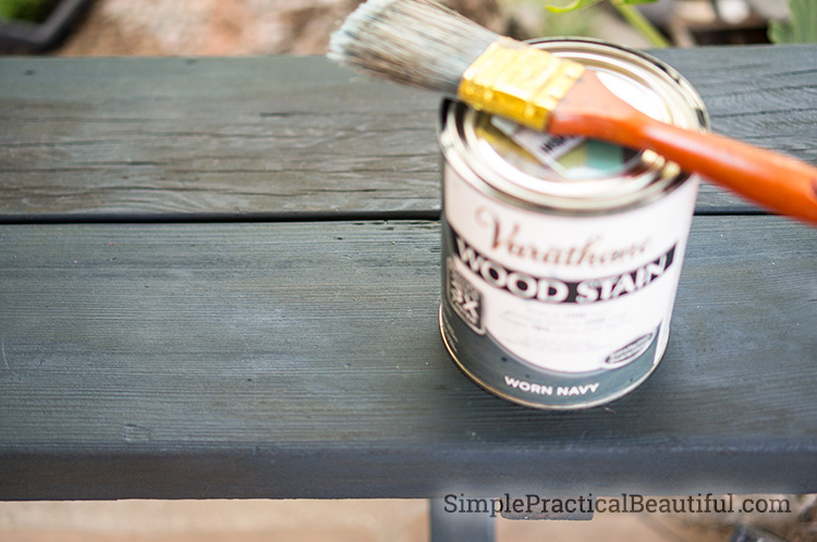 Tutorial on how to turn an old, grey wood bench into colorful patio furniture. Easy DIY project.