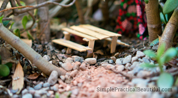 A fairy picnic table made from popsicle sticks.