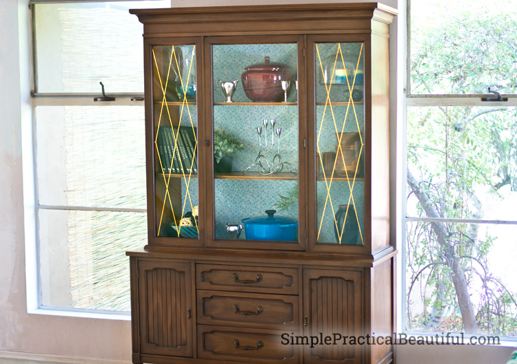 Bring color and light to any cabinet or bookshelf by adding removable wallpaper to the back.
