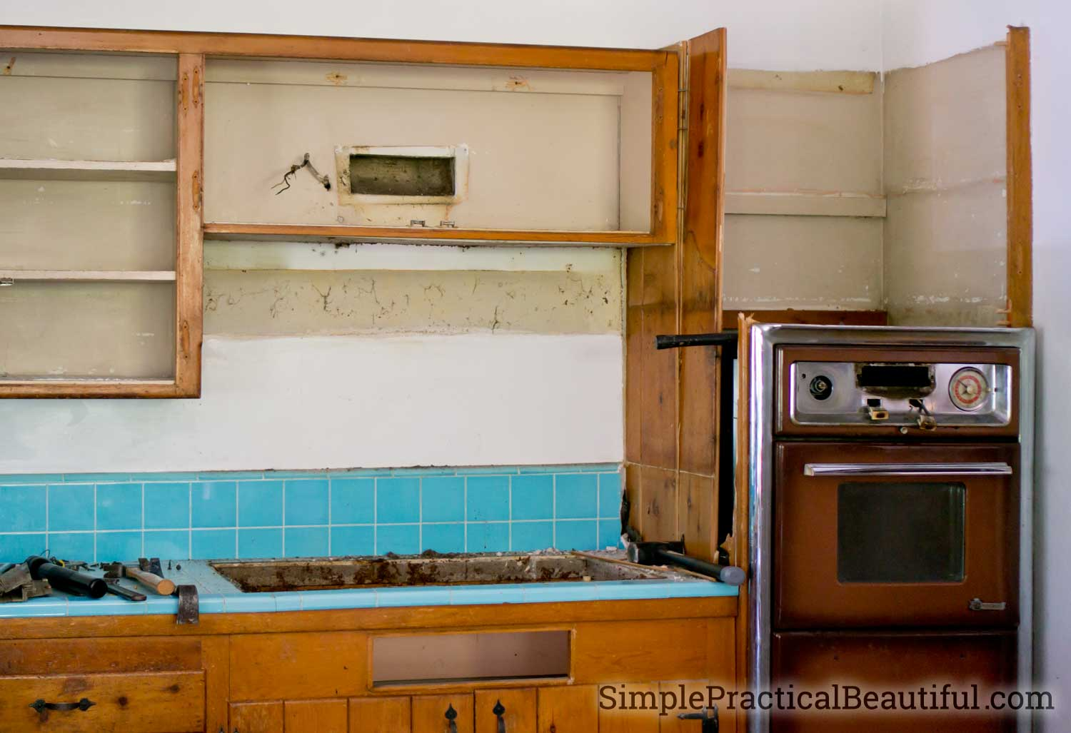 removing the cabinets around a vintage oven and gas cooktop