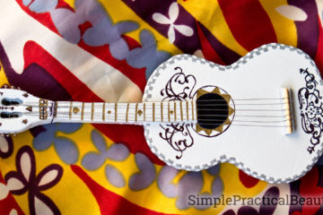 A miniature guitar made to look like the Coco guitar