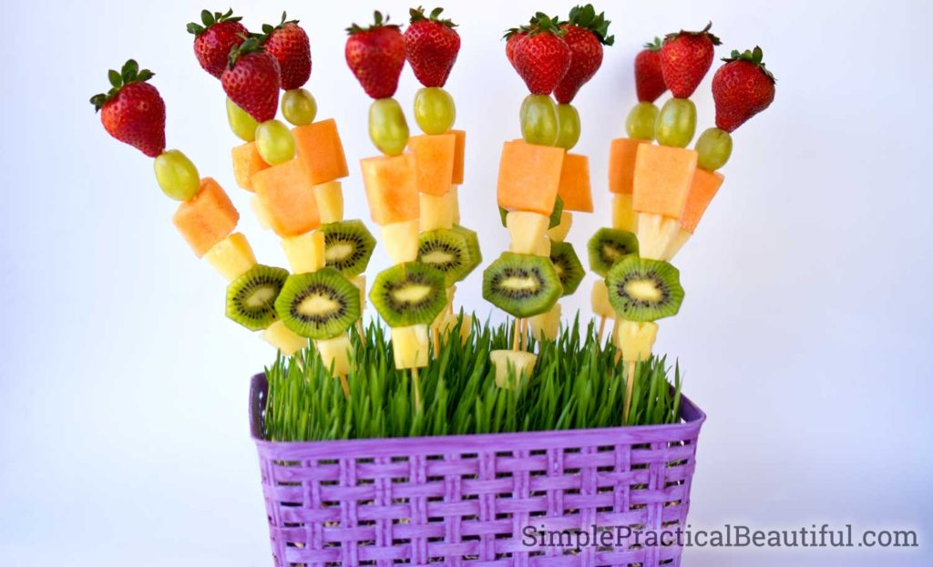 Fruit kabobs with strawberries, grapes, cantaloupe, pineapple, and melon perfect for a spring brunch