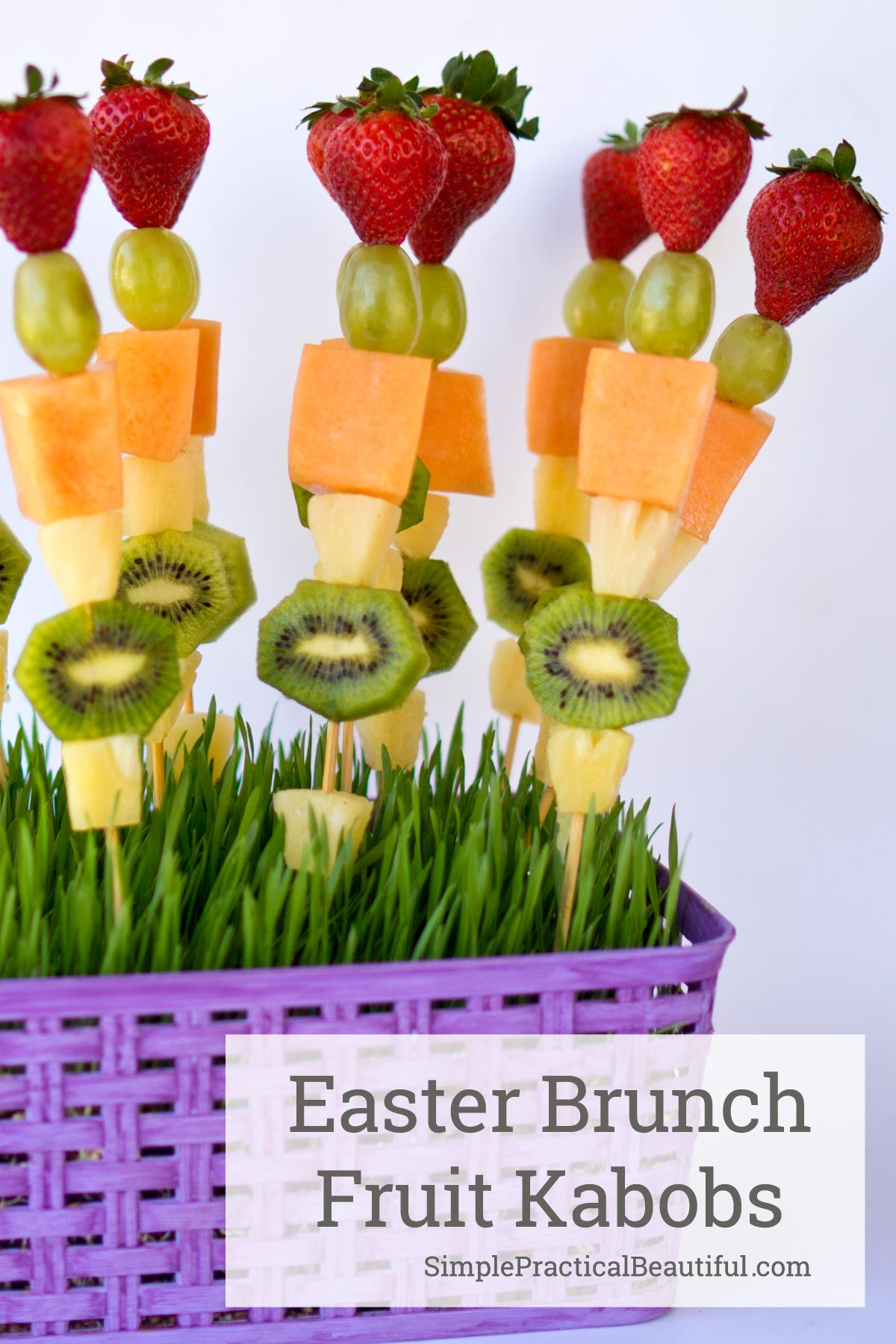 Serve Easter brunch fruit kabobs in a basket filled with wheat grass | brunch idea