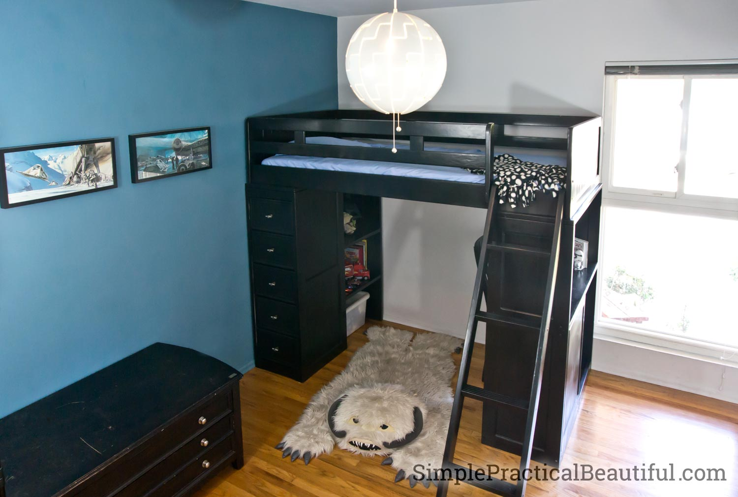 A loft bed refinished in black to work in a Star Wars bedroom
