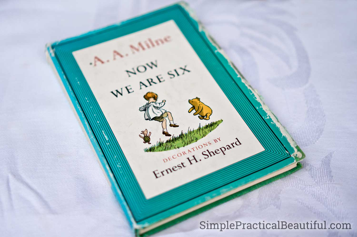 "A treasured Winnie the Pooh and Christopher Robin book by A.A. Milne called ""Now We Are Six"""