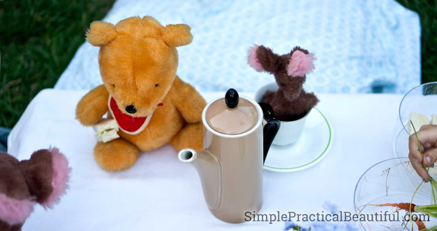 Winne the Pooh and little Too enjoy a cuppa at Christopher Robin's tea party