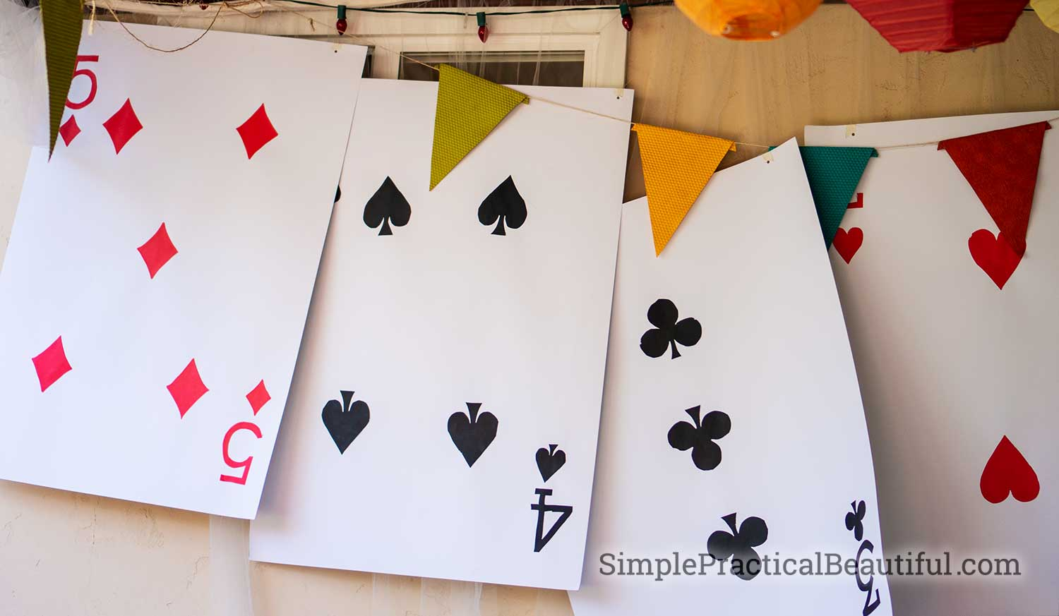 Giant Face Cards as decoration for a Mad Hatter's tea party at an Alice in Wonderland birthday