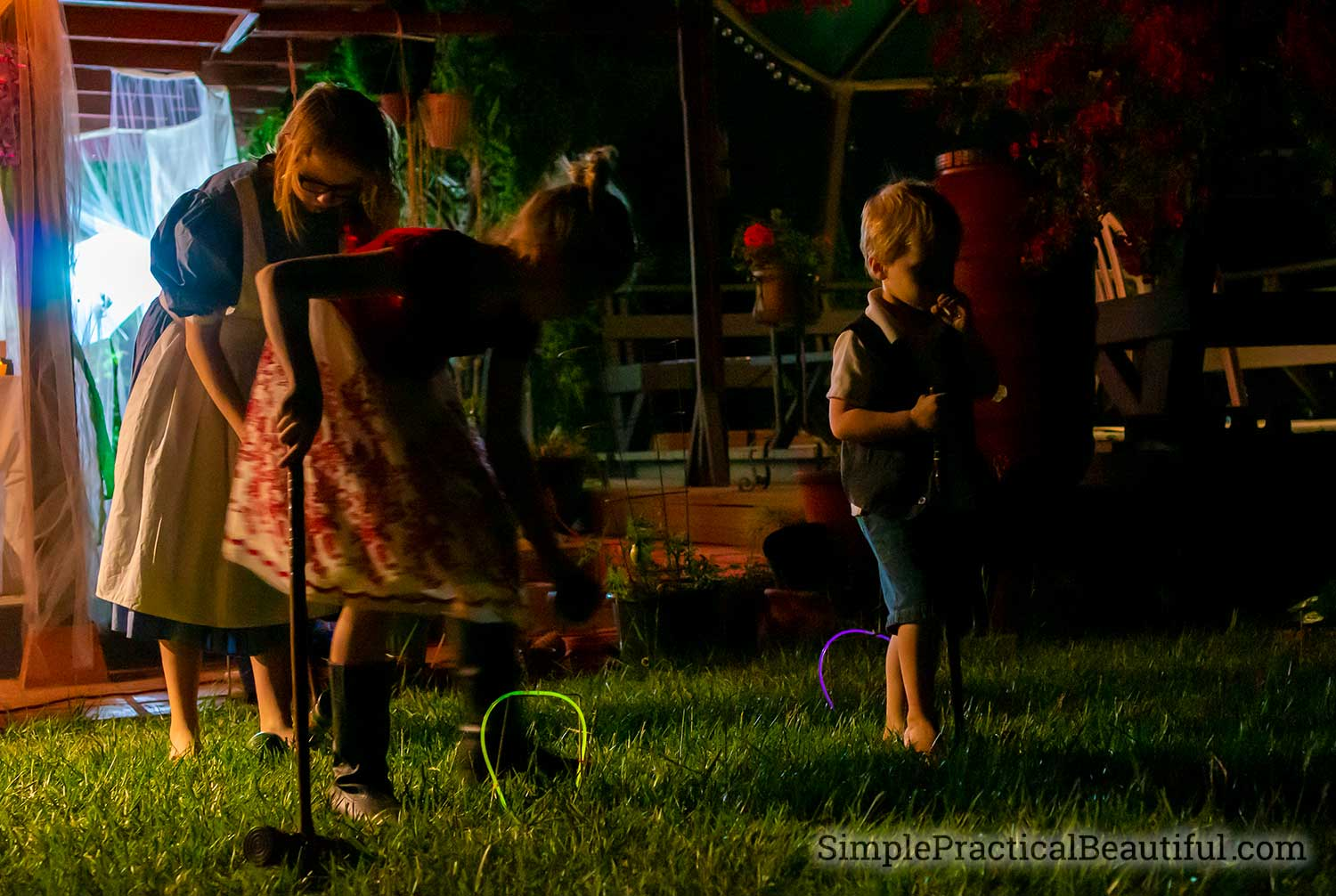 Glow in the dark croquet game at a Alice in Wonderland party