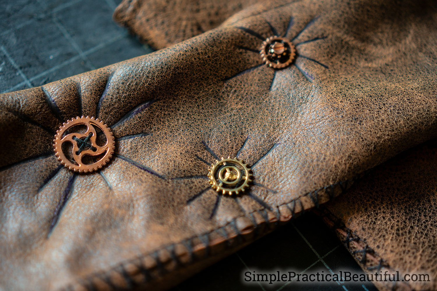 Steampunk fingerless leather gloves with gears hand sewn on