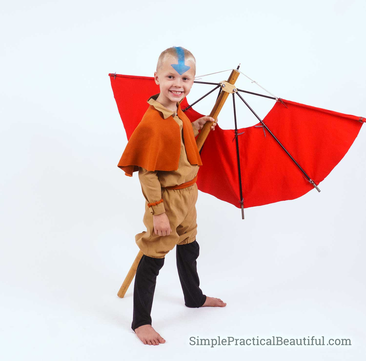 Aang costume with a DIY Airbender staff